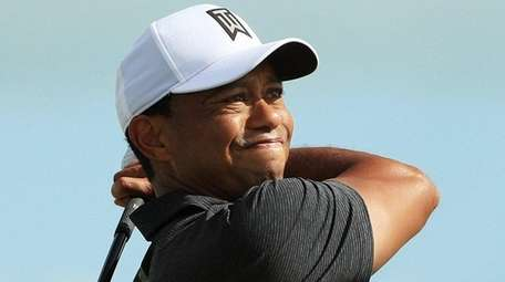 Tiger Woods plays his shot from the seventh