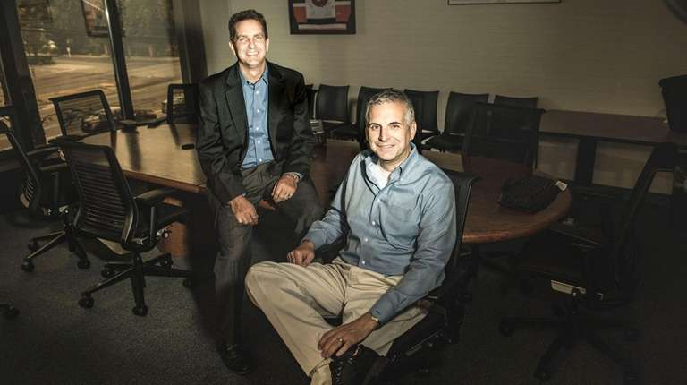 LBI Software president Richard Teed, right, and vice