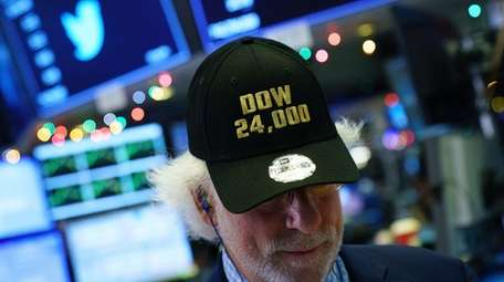 A trader wears a 'Dow 24,000' hat as