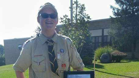 Boy Scout Jordan Waitkus installed pedestals with the