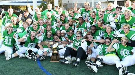 Seaford players surround coach Rob Perpall and the