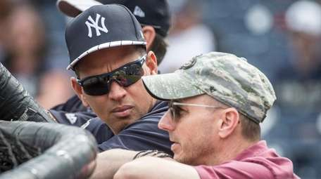 Alex Rodriguez talks with general manager Brian Cashman
