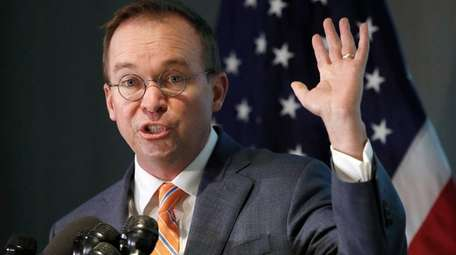 Mick Mulvaney speaks at a news conference on