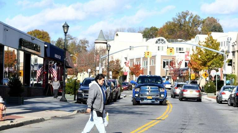 A pedestrian on School Street, the downtown shopping