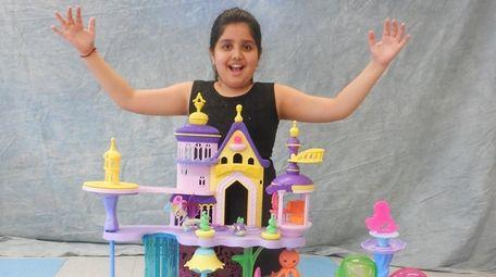 Kidsday reporter Aanya Dhamiija with the Seaquestria Castle.