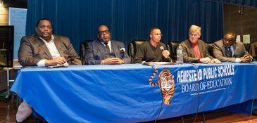 Members of the Hempstead school board, from left,