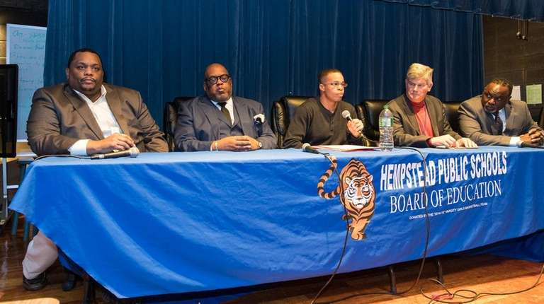 Members of the Hempstead school board, from left,