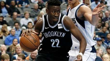 Brooklyn Nets guard Caris LeVert (22) works for
