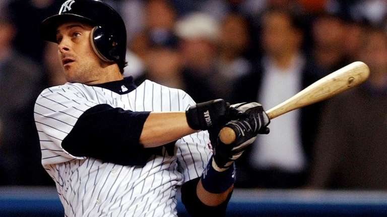 Yankees' Aaron Boone watches his game-winning home run