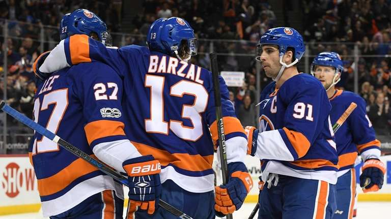 New York Islanders players congratulate left wing Anders