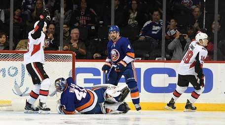 Islanders goalie Jaroslav Halak lays on the ice