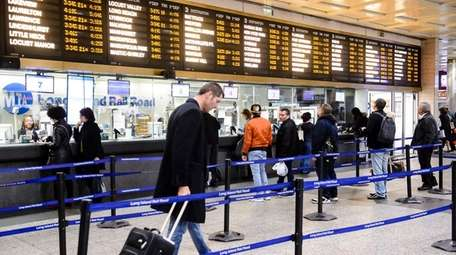 LIRR commuters purchase train tickets from ticket windows