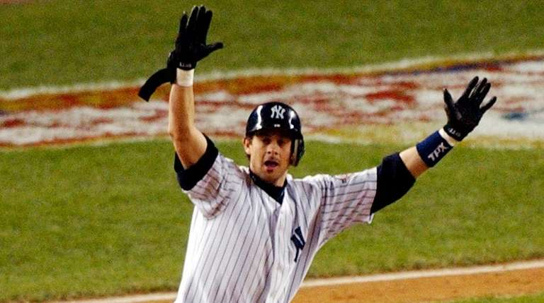 The Yankees' Aaron Boone celebrates his game-winning home