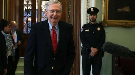 Senate Majority Leader Sen. Mitch McConnell walks from