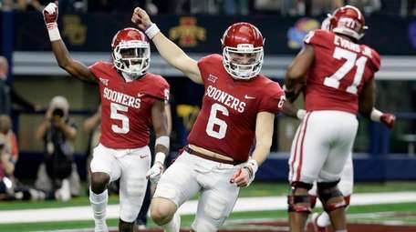 Oklahoma quarterback Baker Mayfield and wide receiver Marquise