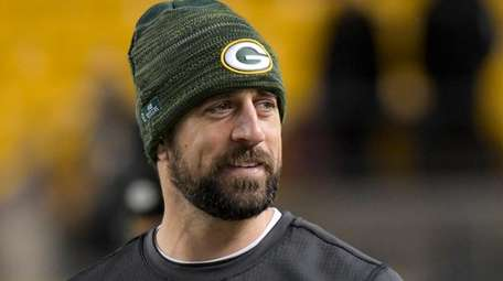 Green Bay Packers injured quarterback Aaron Rodgers watches