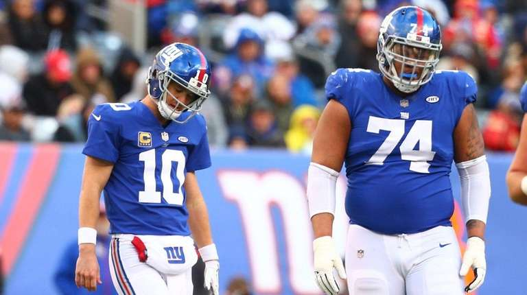 Eli Manning and Ereck Flowers of the New