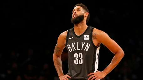 Allen Crabbe of the Brooklyn Nets looks on