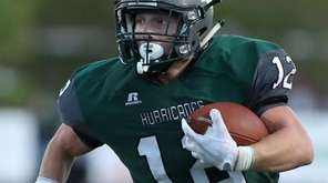 Dylan Laube runs for a touchdown during the