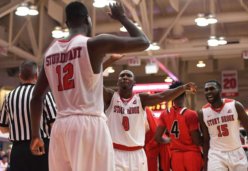 Stony Brook guard Jaron Cornish (0) congratulates forward