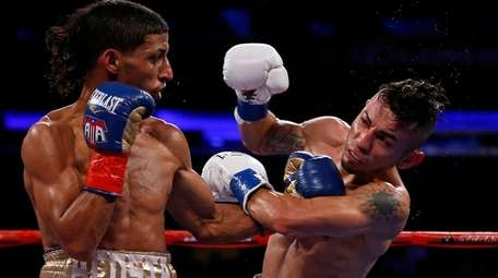 Angel Acosta punches Juan Alejo, of Mexico, during