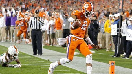 Clemson's Kelly Bryantruns for a touchdown against Miami