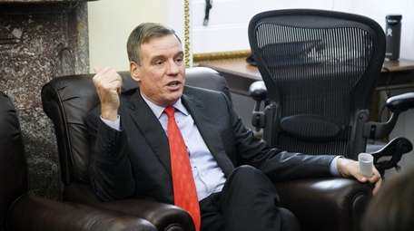 Sen. Mark Warner (D-Va.) speaks during a meeting