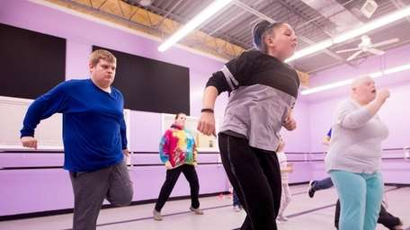 Students and teachers attend a dance class for