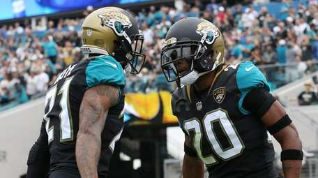 Jalen Ramsey and A.J. Bouye of the Jaguars