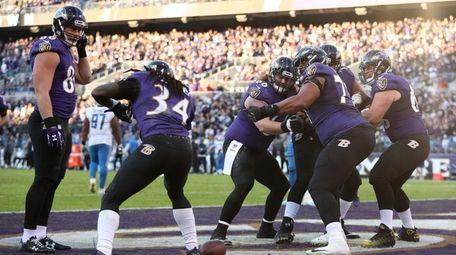 Alex Collins of the Ravens celebrates with teammates