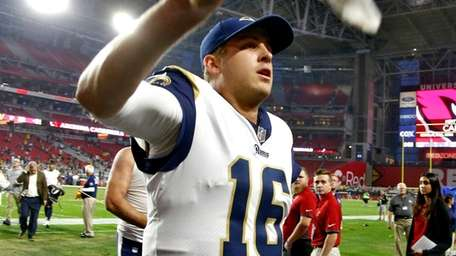 Rams quarterback Jared Goff leaves the field after