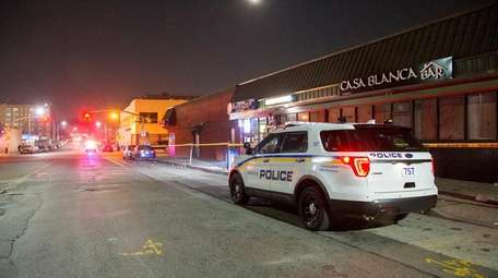 Police investigate the early morning stabbings Monday, Dec.