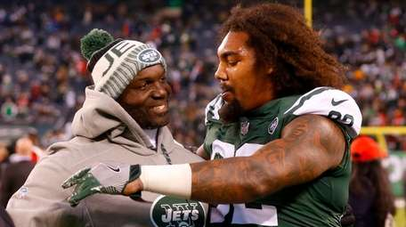 Head coach Todd Bowles and Leonard Williams of