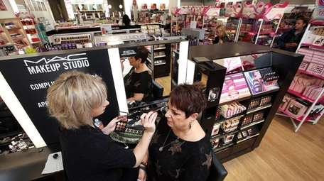 Ellen Tjimos of Bethpage sits for a makeup