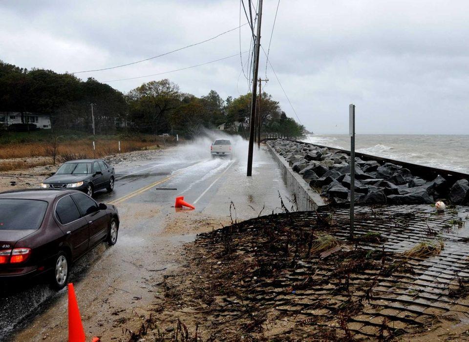 Ocean water crashes onto the road near Asharoken