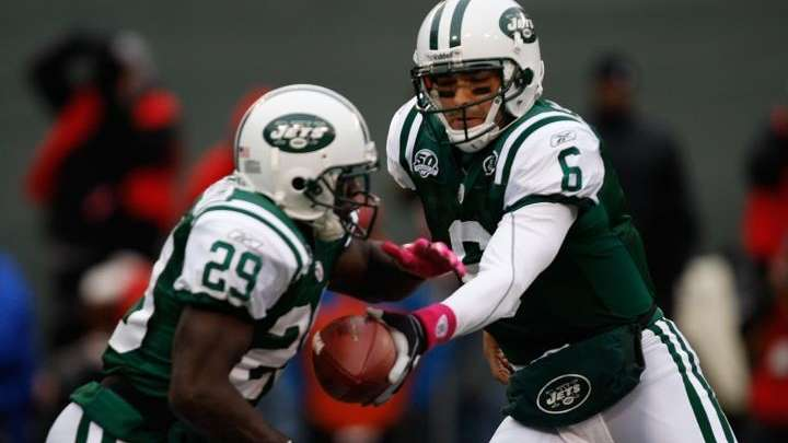 Mark Sanchez #6 hands off the ball to
