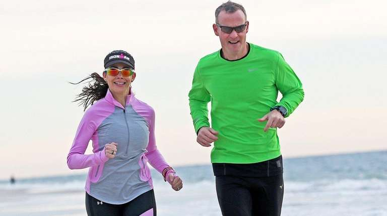 Matt Conroy runs with his fiancee, Eliana Themistocleous,