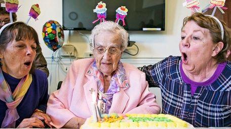 Sister Grace Regina Wingenfeld, center, celebrates her 106th