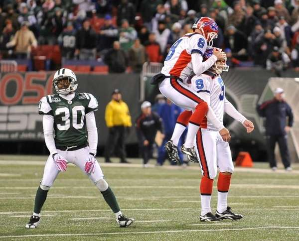 Bills' #8 Brian Moorman leaps on top of