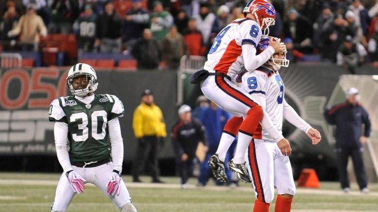 Bills' #8 Brian Moorman leaps on top of
