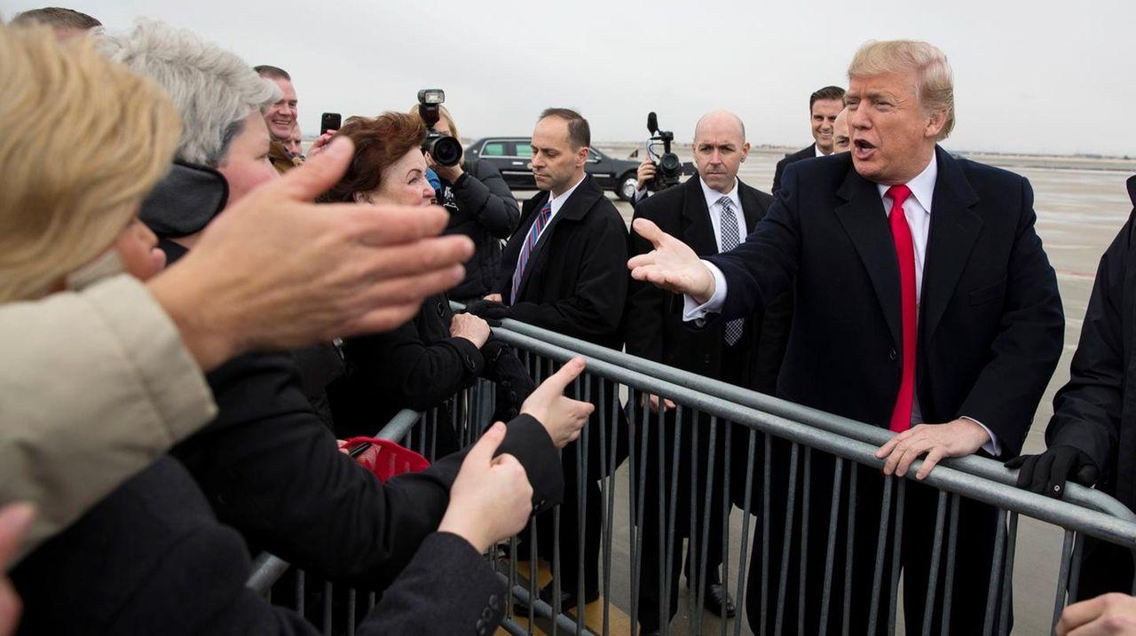 President Donald Trump arrives at Salt Lake City