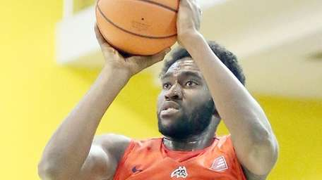 Stony Brook's Akwasi Yeboah shoots from outside against