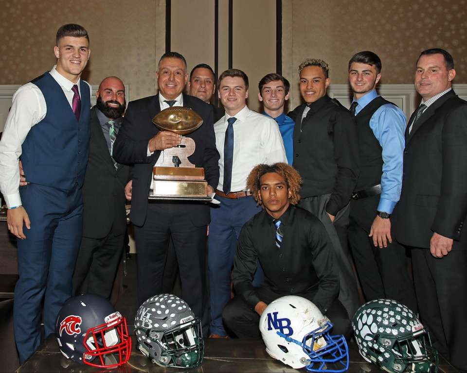 Lindenhurst head coach Nick Lombardo and players hold