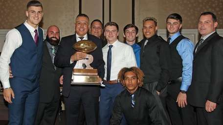 Lindenhurst head coach Nick Lombardo holds the Rutgers
