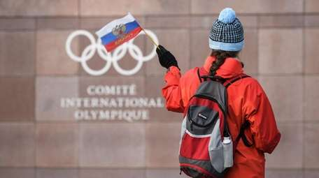 A supporter waves a Russian flag in front