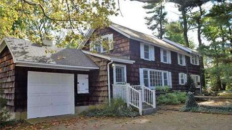 The $579,000 Centerport home includes a former