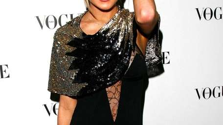 Lindsay Lohan attends the 90 years of Vogue
