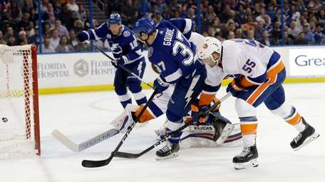 Lightning center Yanni Gourde fires the puck into