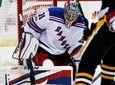 Rangers goalie Ondrej Pavelecstops a shot by the