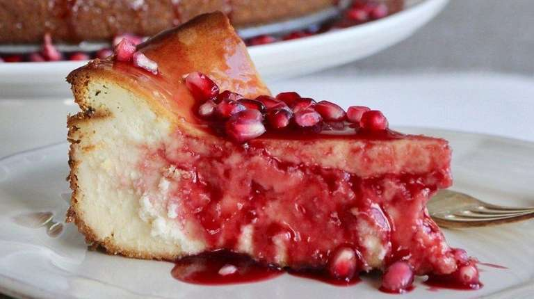 Cheesecake is topped with pomegranate sauce made from